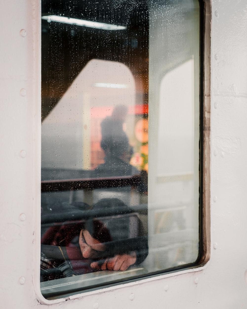 woman lying near window