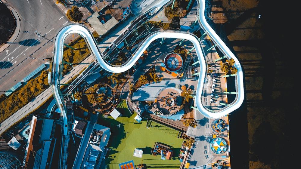aerial photo of white pool slide at daytime