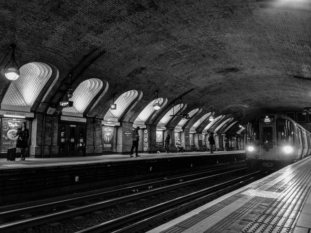 man standing on train station
