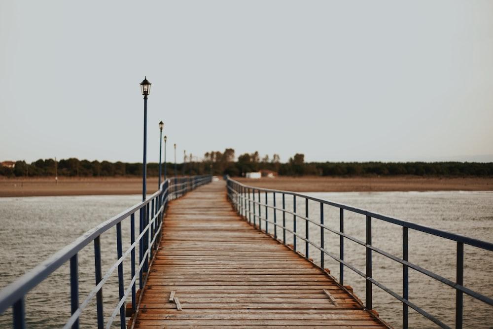 brown bridge with gray steel railings