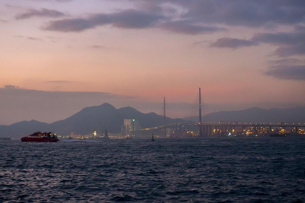 fishing boat on ocean near the city