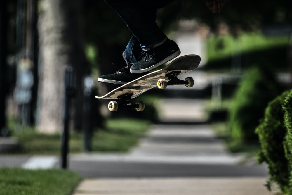 person riding on skateboard doing exhibition trick