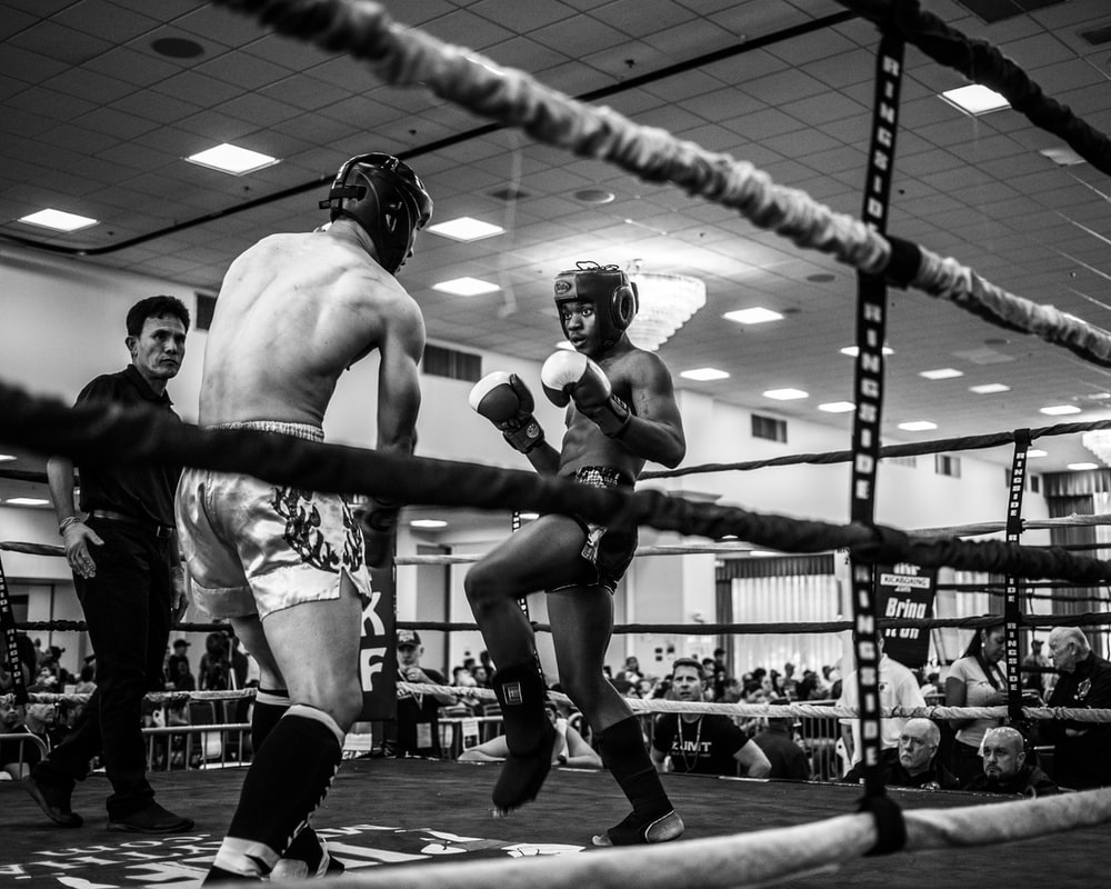 grayscale photo of boxing sparring