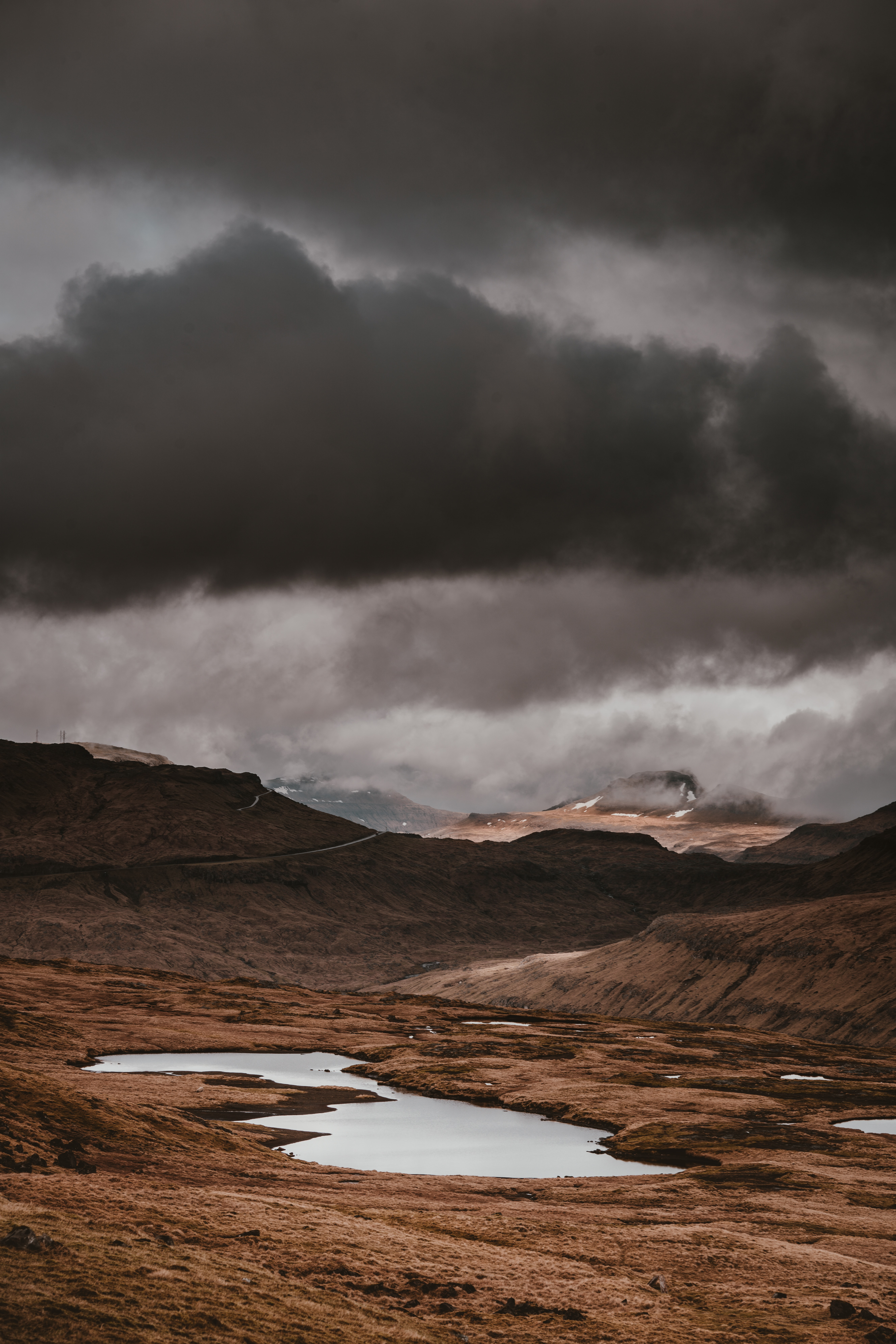gray clouds over vast dry land