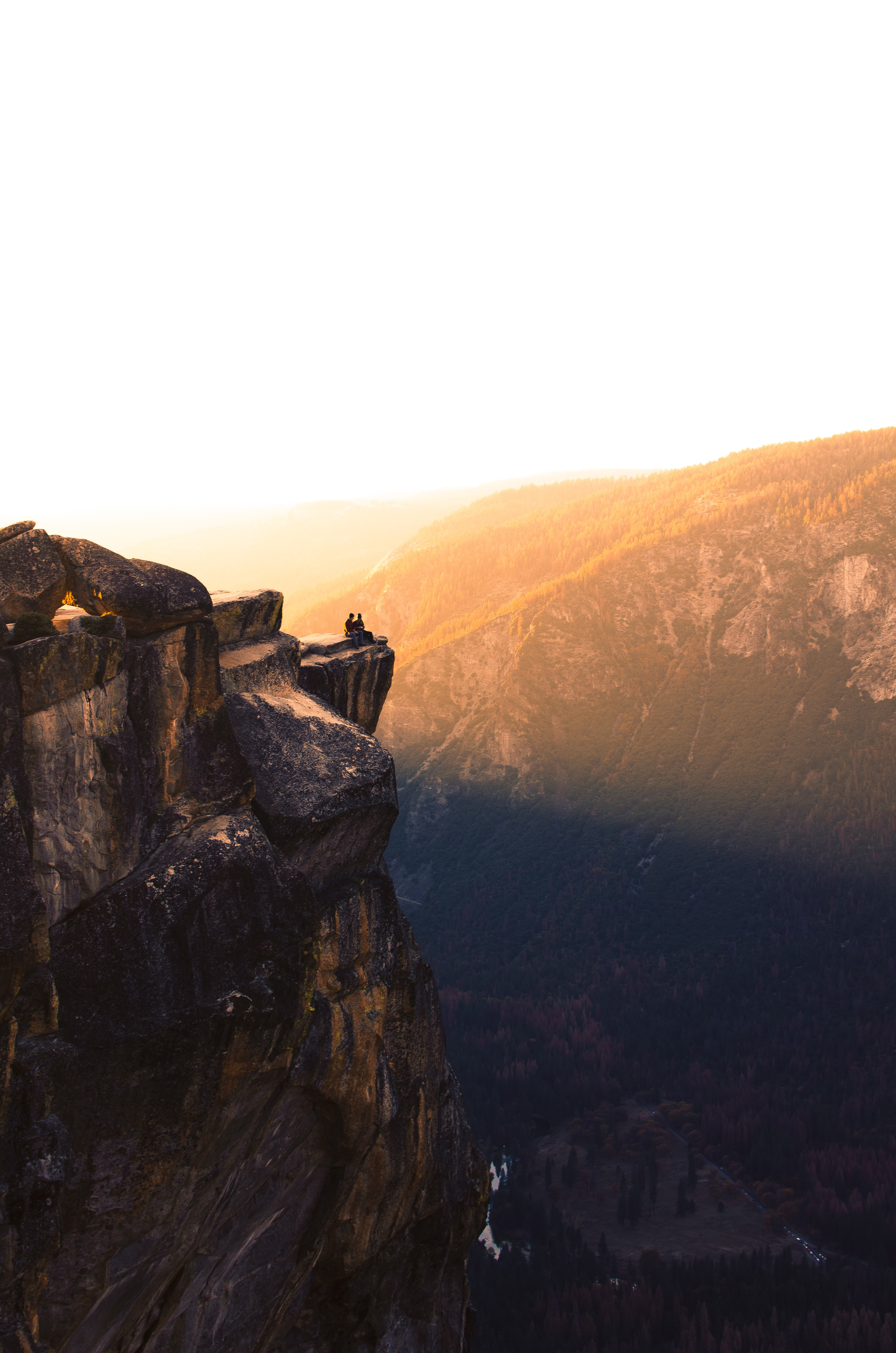 two person on sitting cliff