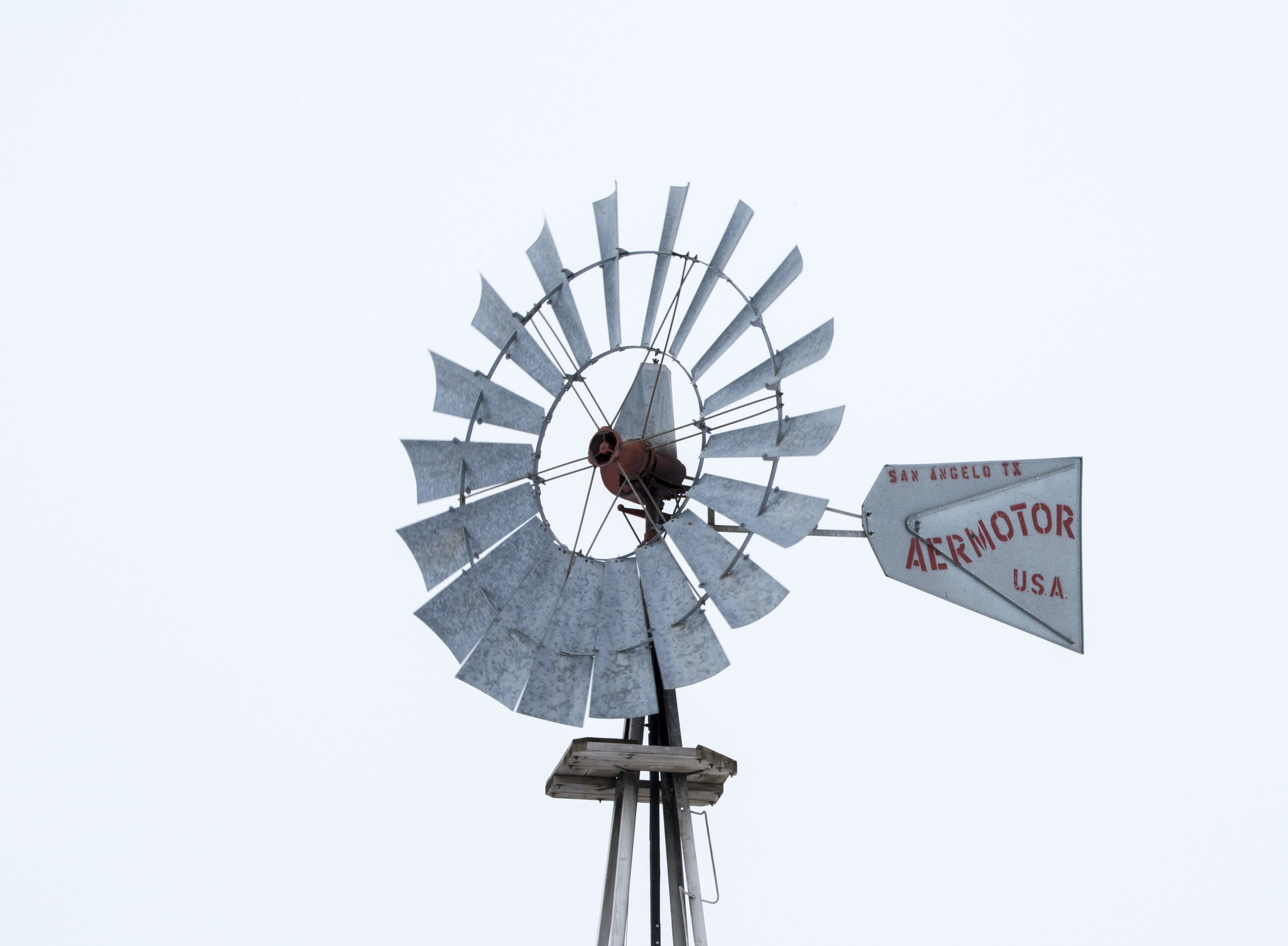 low angle photography of gray windmill