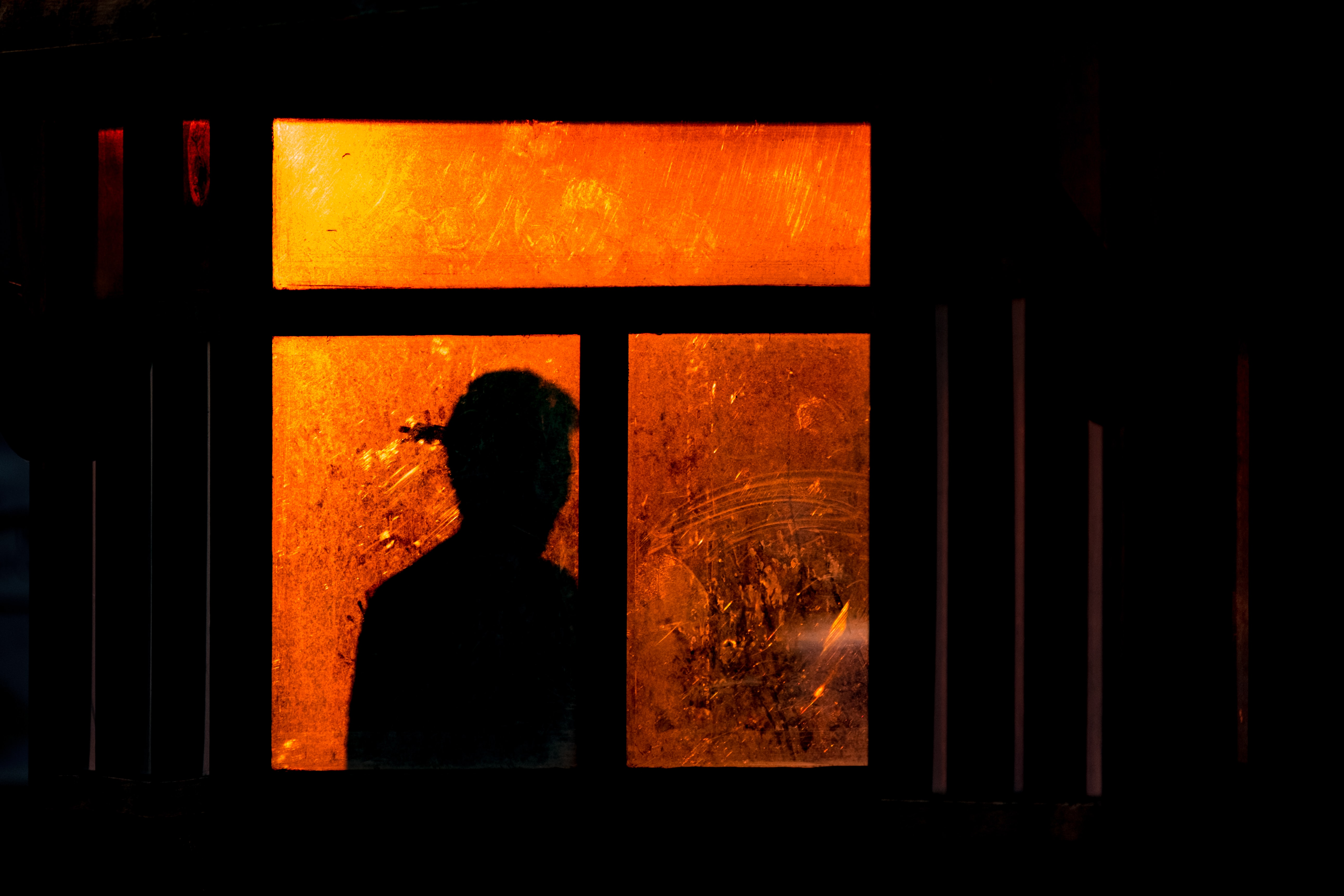 silhouette of a person at the window