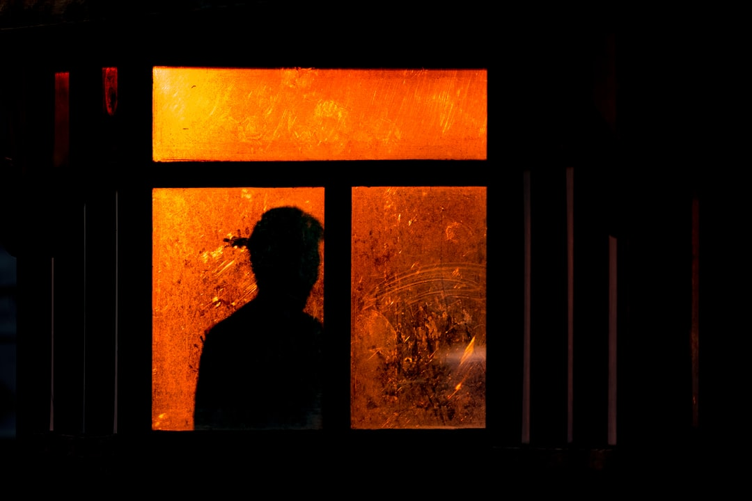 It was just round sunset and someone was witing at a bus stop.  His silhouette against the window illuminated by the setting sun seemed somewhat creepy…