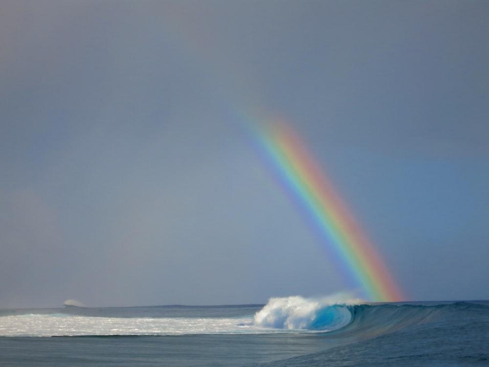 sea wave beside rainbow
