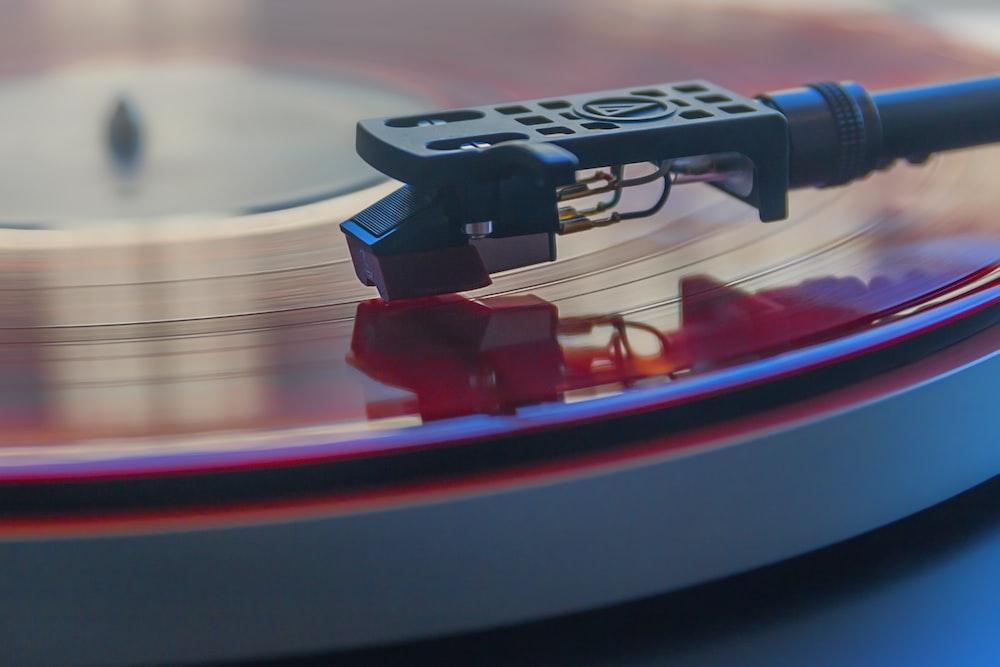 closeup photography of vinyl record in vinyl player