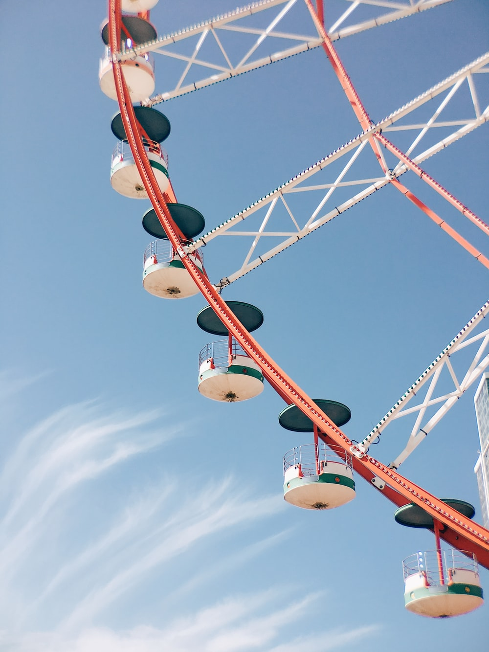 white and blue metal ferris wheel in closeup photography