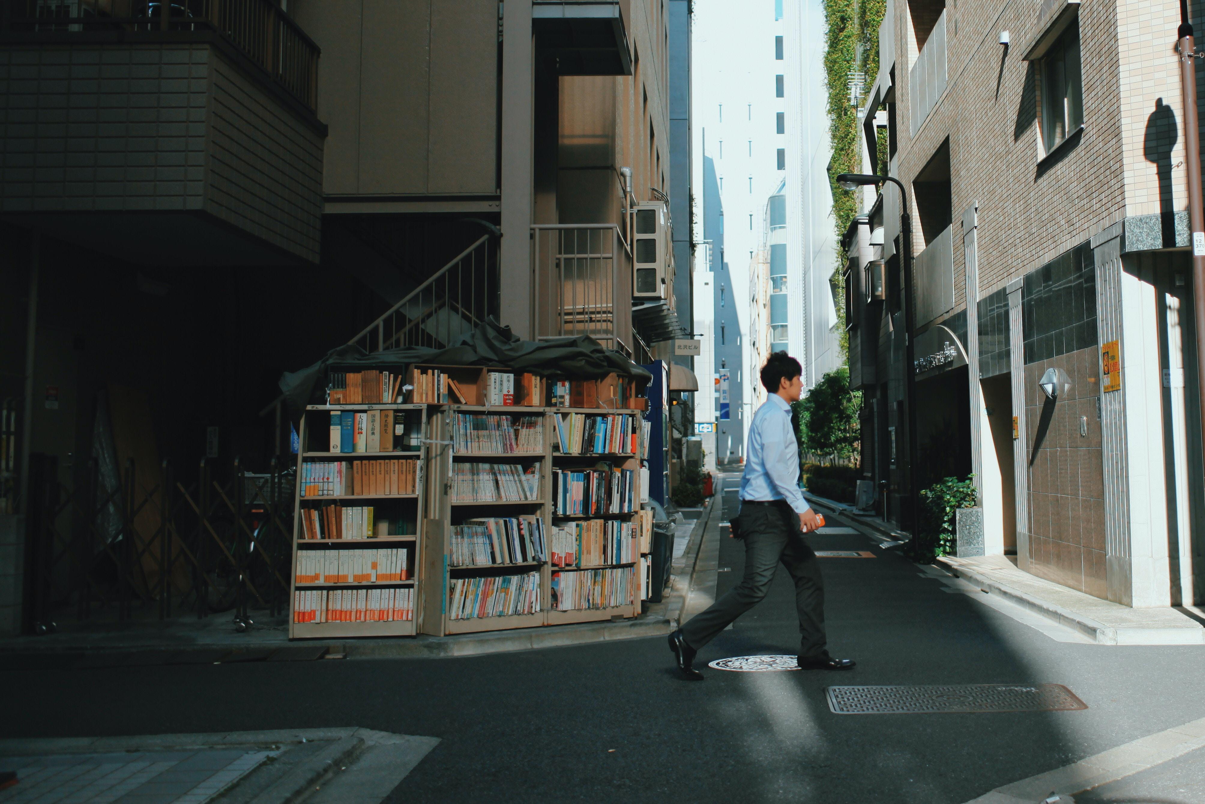 man crossing the street