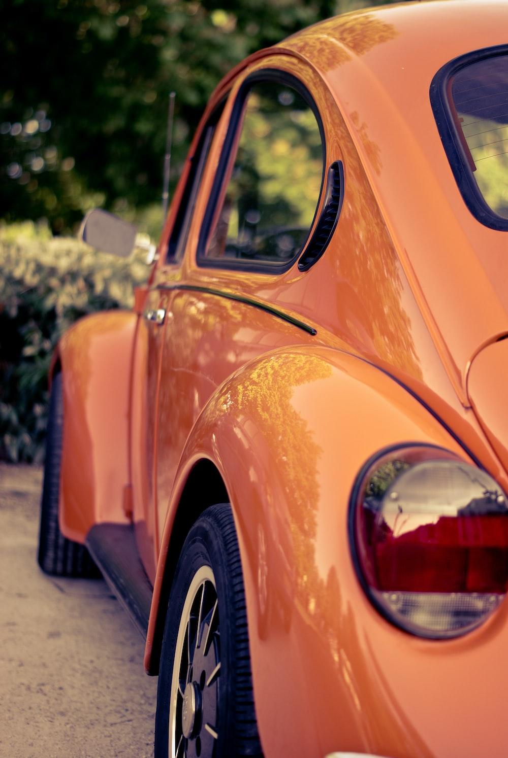 orange Volkswagen Beetle
