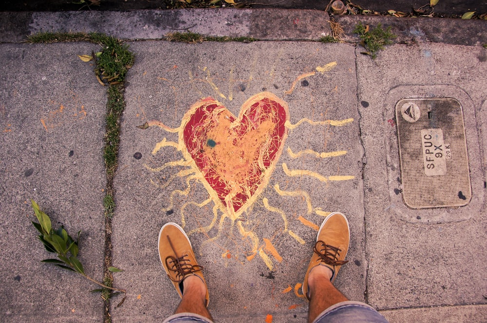 person standing near heart paint