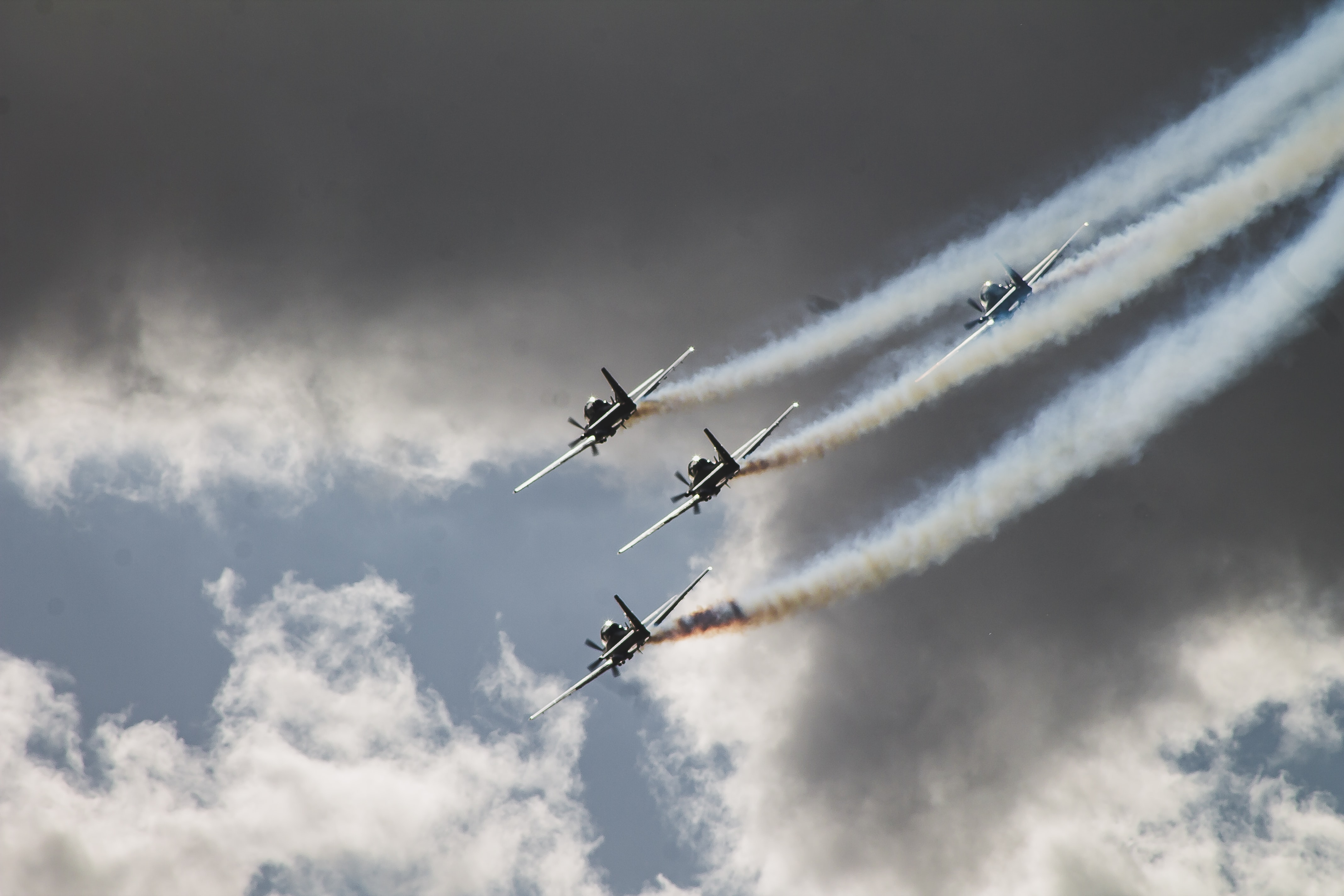 four black planes flying in sky