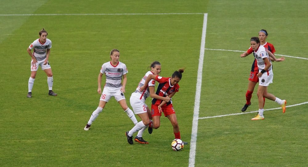 group of females playing soccer