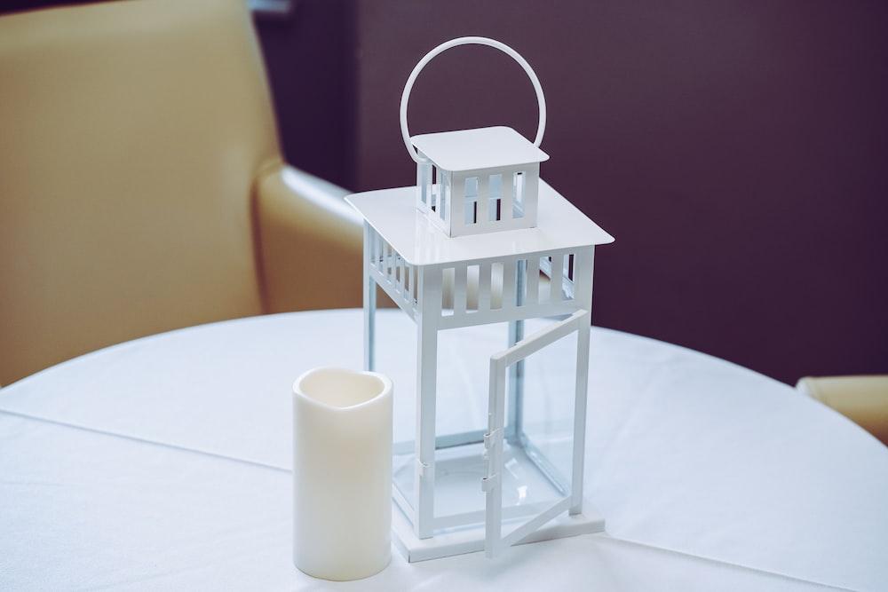 white steel pendant lamp on white wooden table