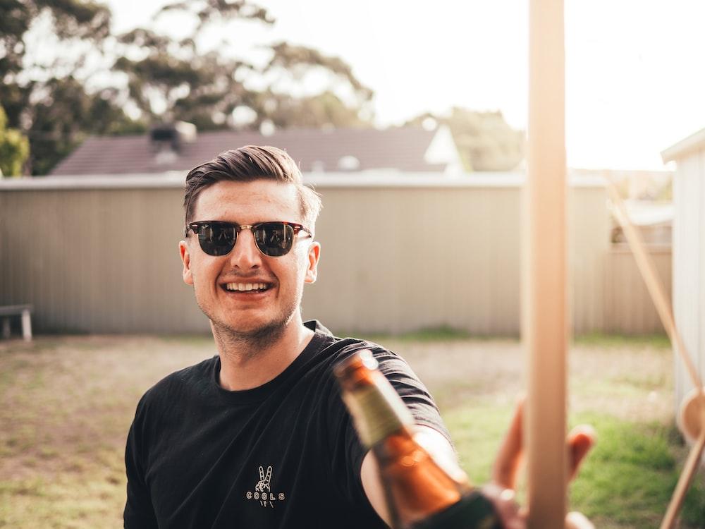 man smiling while taking photo