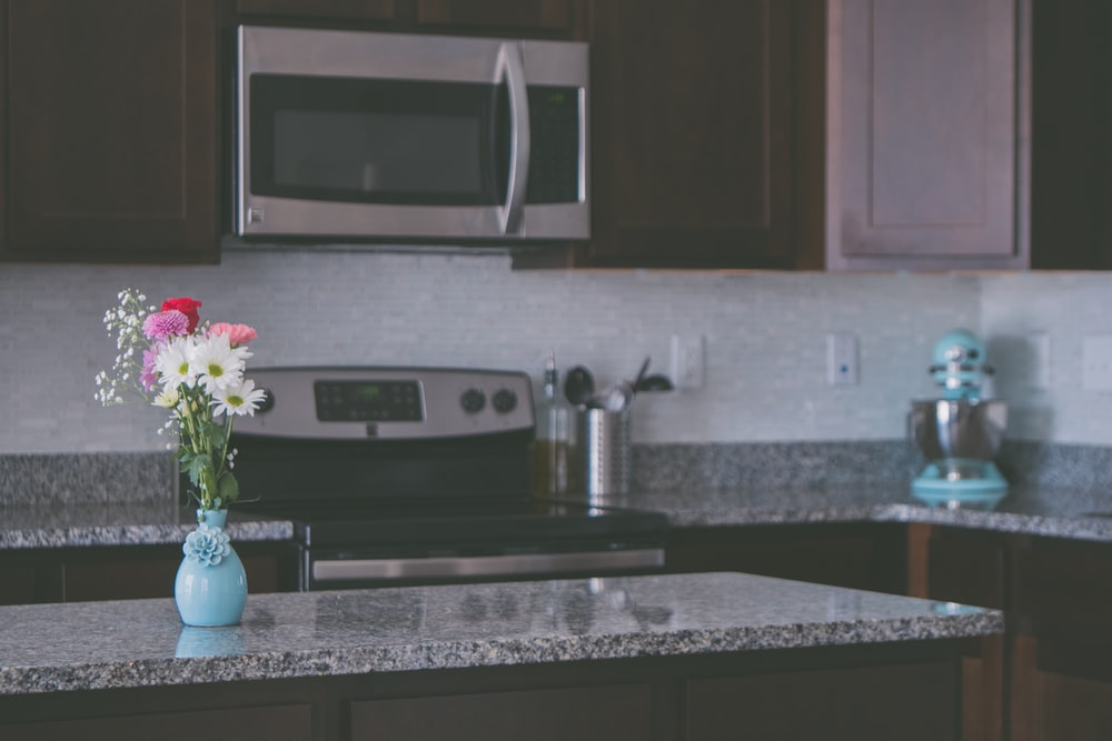 flower arrangement on vase on kitchen island