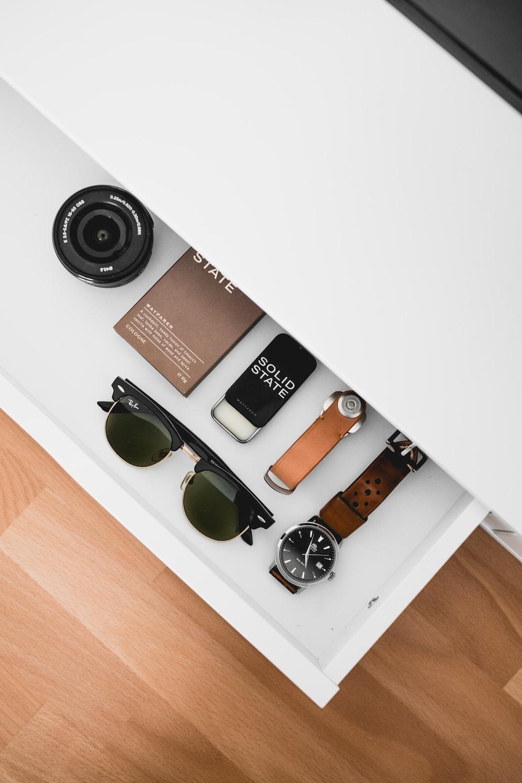 black framed Ray-Ban sunglasses on white drawer