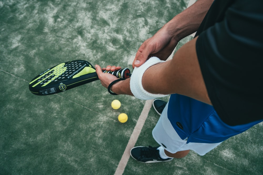 person holding tennis racket