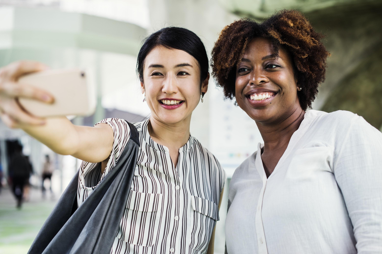 women's white button-up dress shirt smiling
