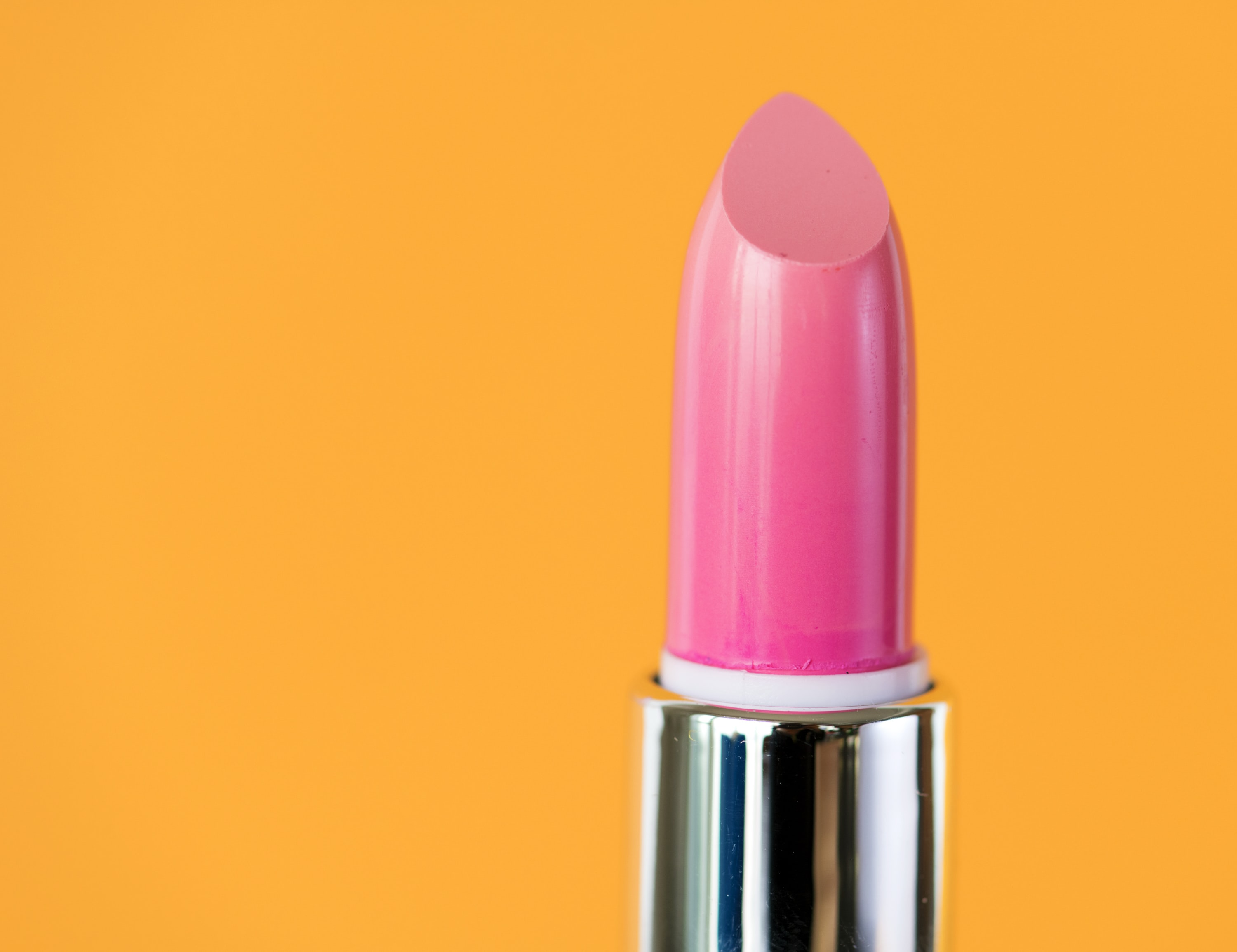 pink lipstick on yellow background