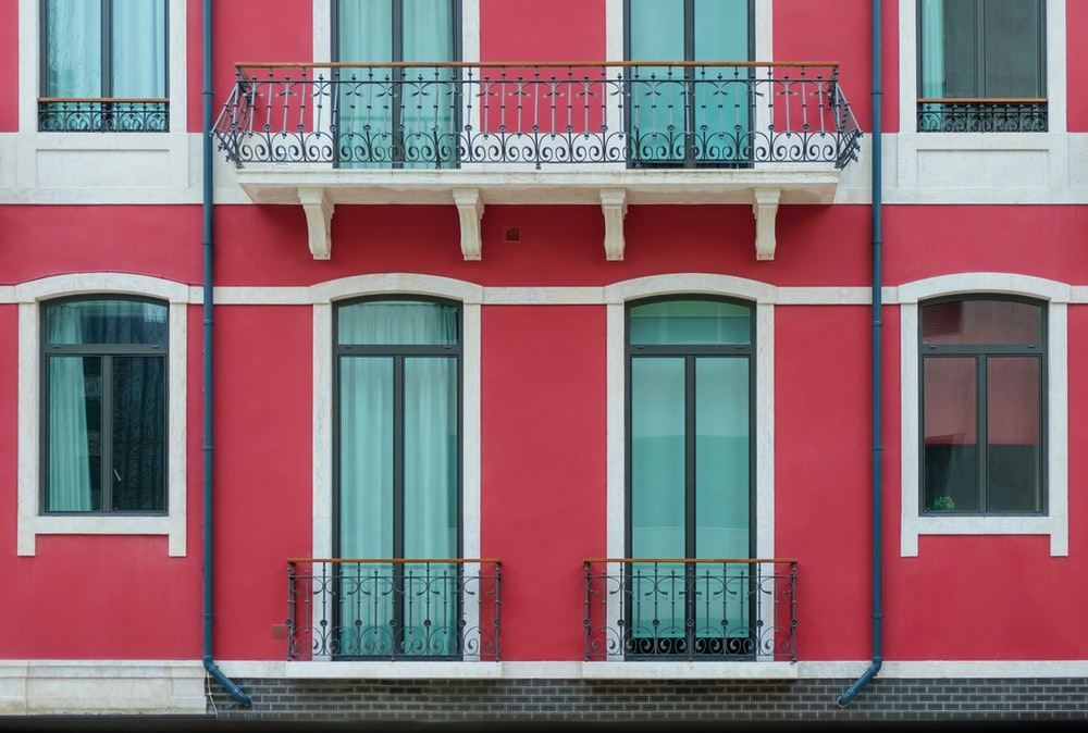 red and white house with balcony