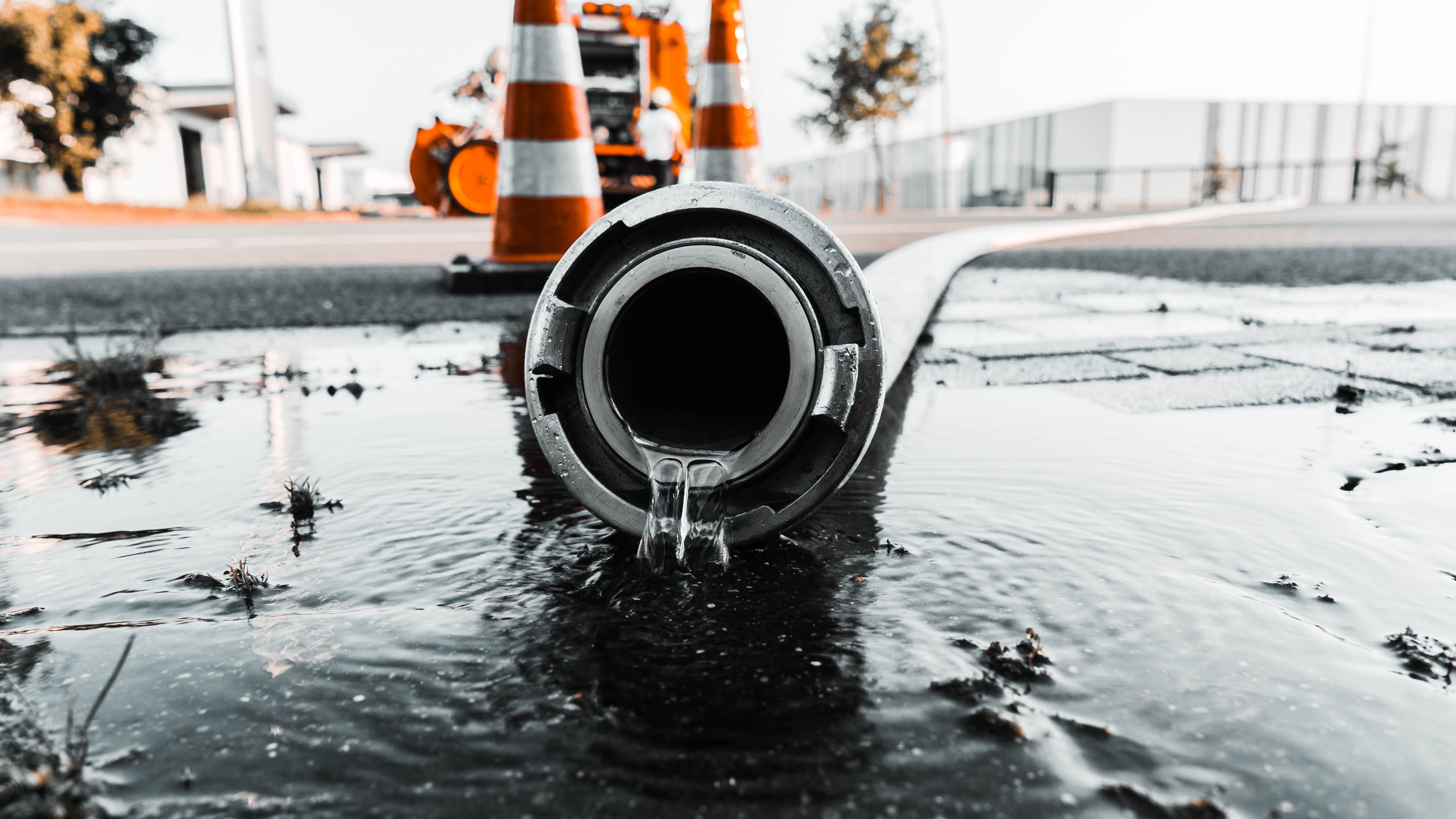 water coming out from gray pipe
