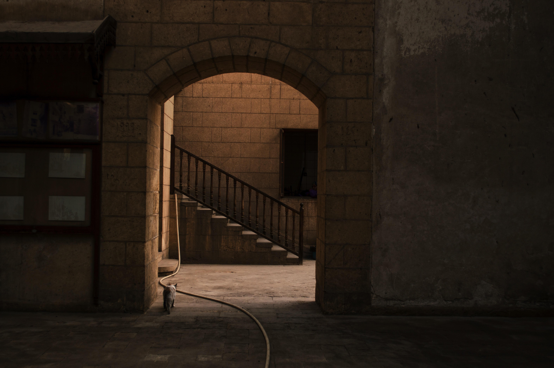gray concrete hallway near gray concrete stairs