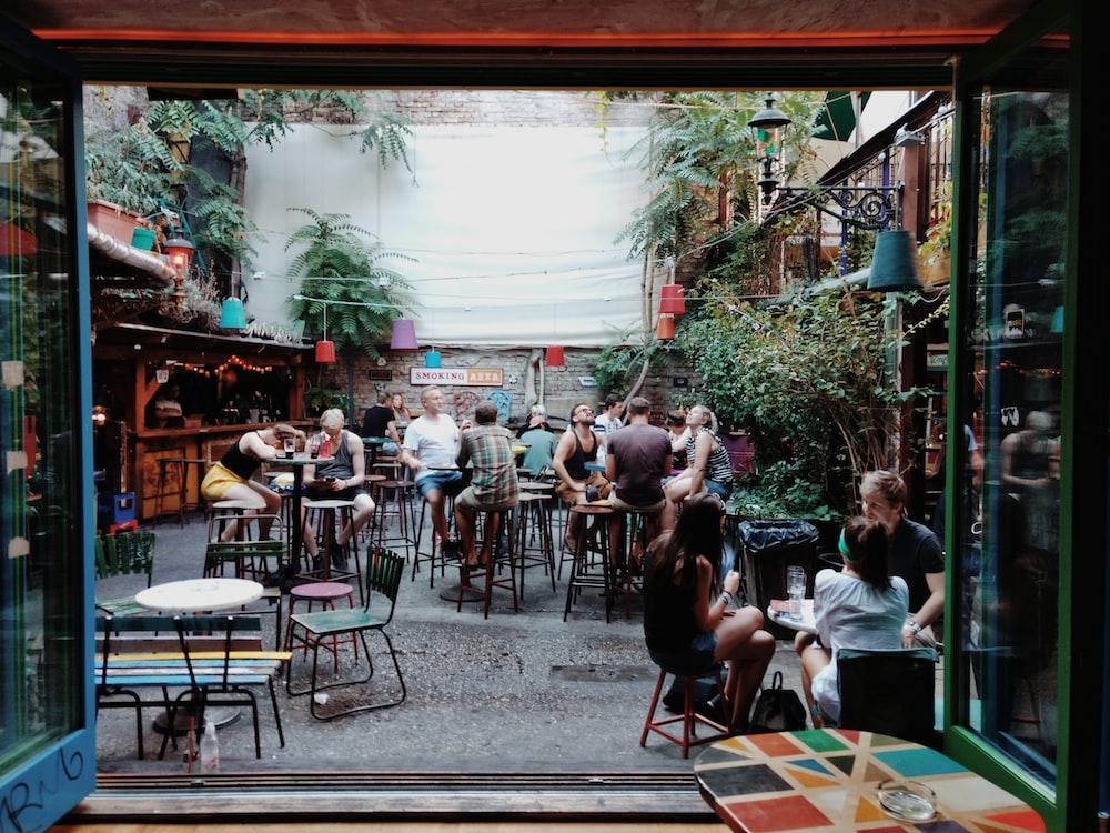 people sitting inside restaurant
