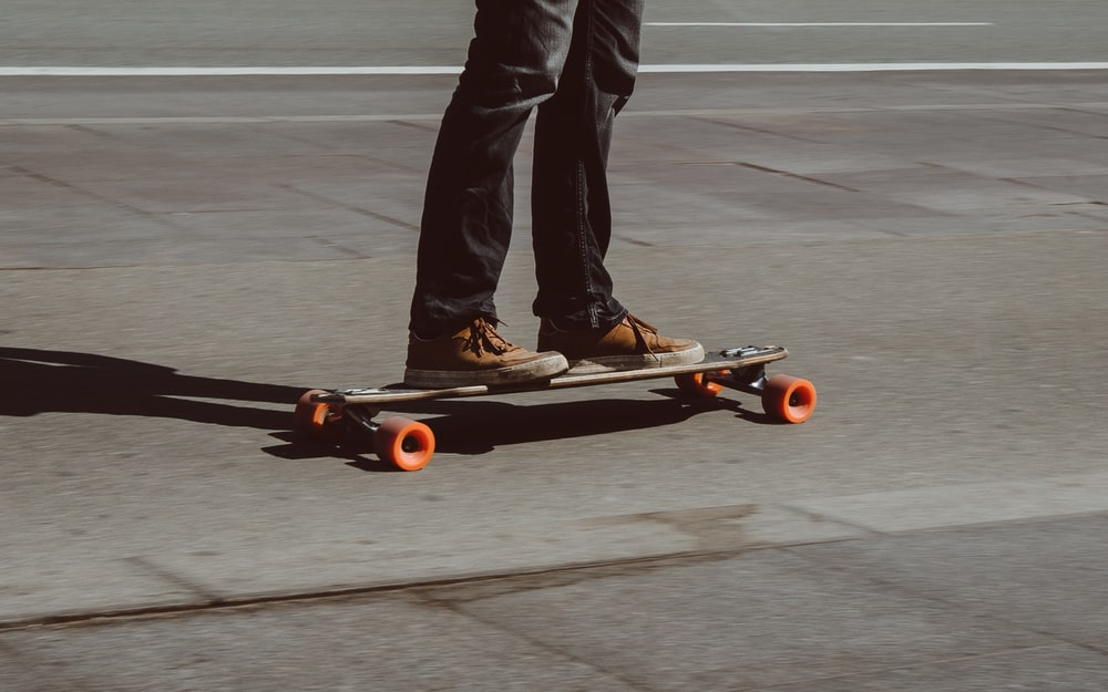 person riding skateboard on road