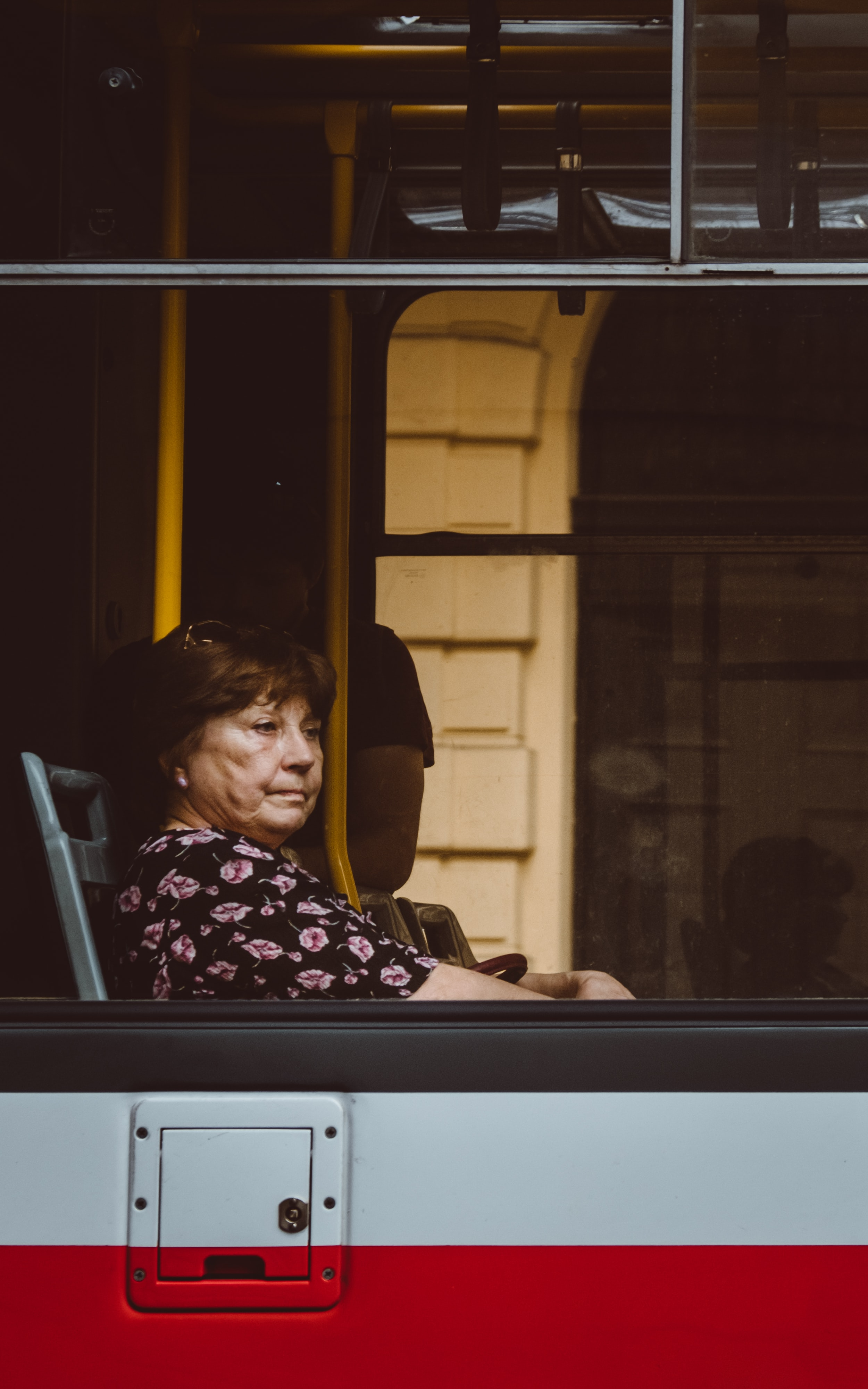 woman sitting inside a white and red vehicle