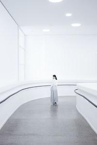 woman standing on hall way