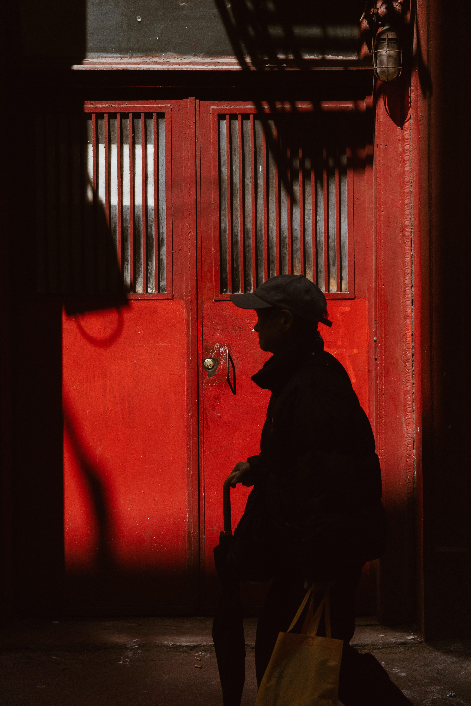 silhouette of person walking in front of door