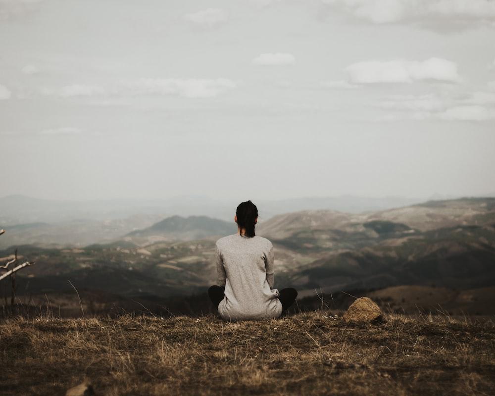 Teenage girl meditating in nature to help quarantine