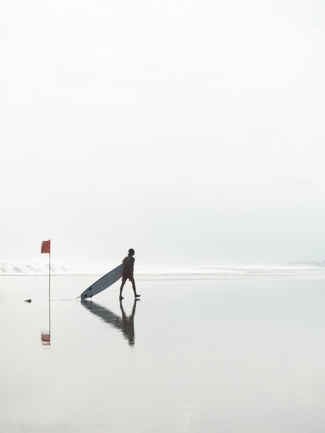 when sun is getting low at double six beach in bali, seashore  becomes a giant mirror. wet sand reflects light letting to take quite cool snaps. had a lot of fun time there chasing surfers with my camera!