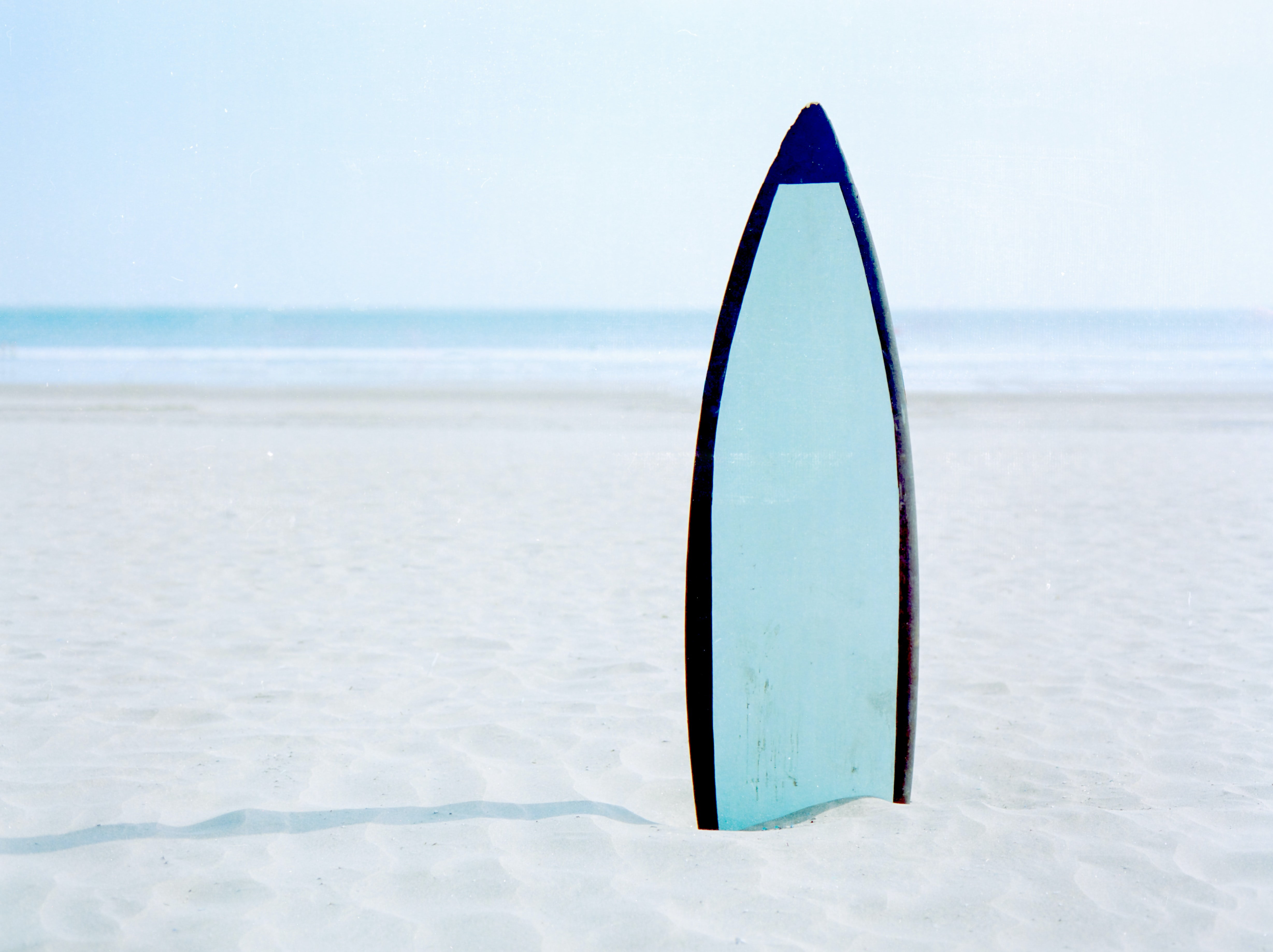 surfboard on seashore