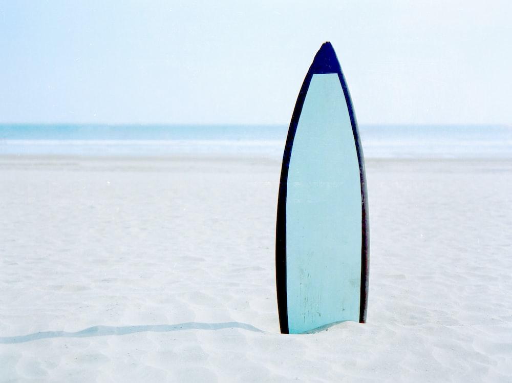 surfboard on seashore