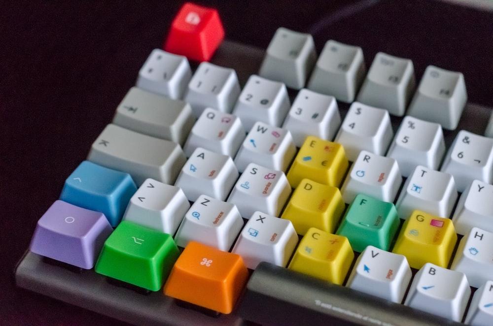 white, orange, green, and purple computer keyboard