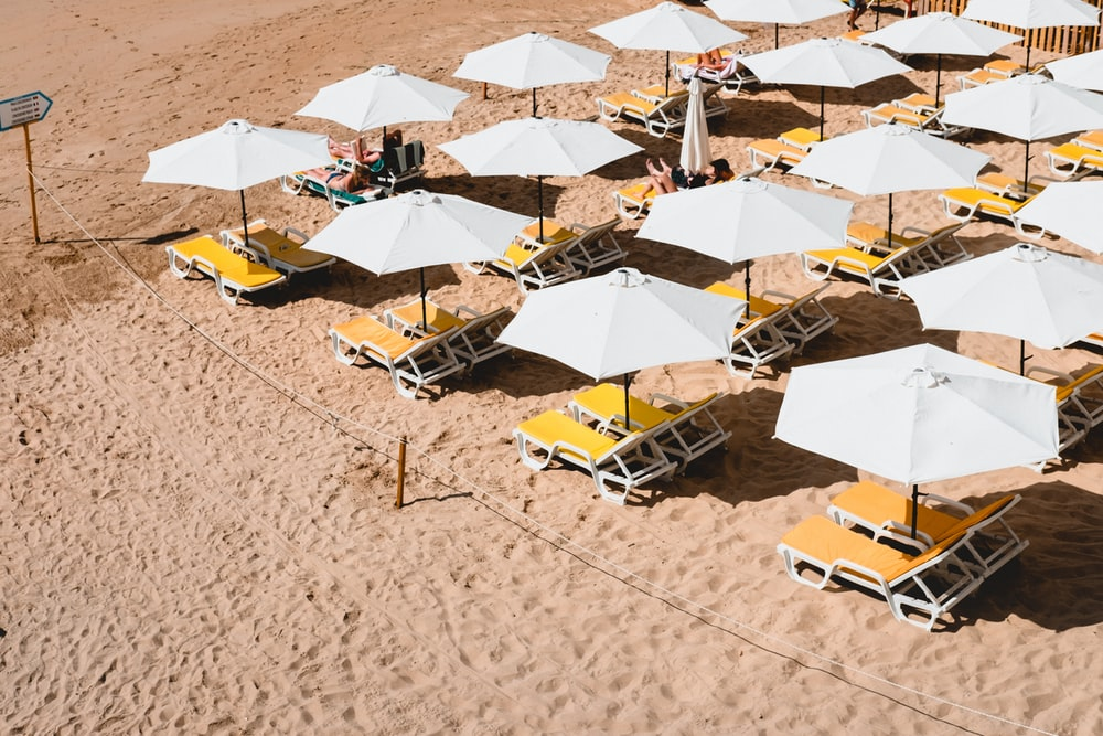 lounge chairs with umbrellas on beach