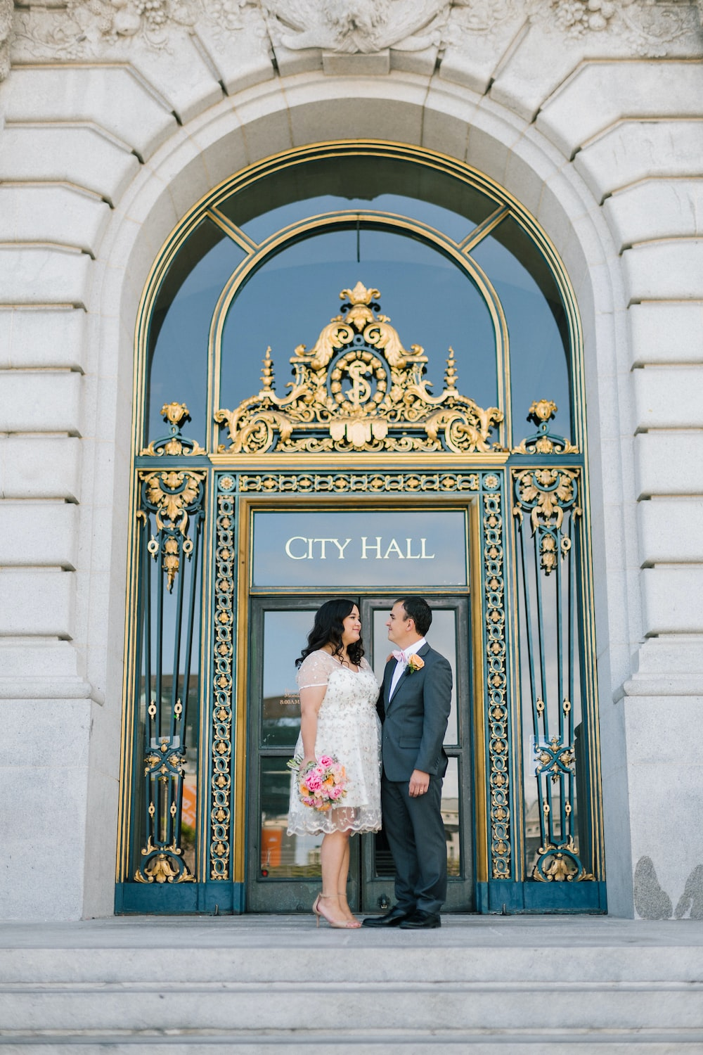 man and woman standing in front of a city hall