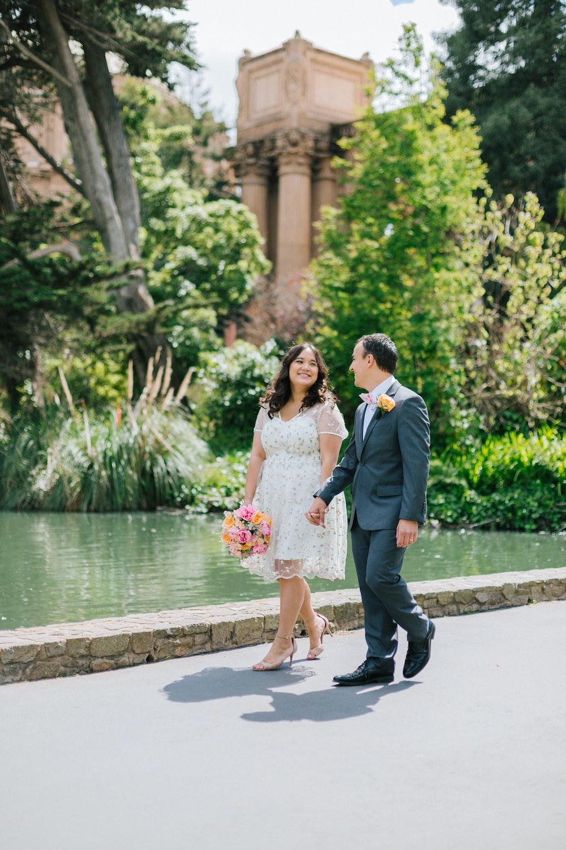 couple walking near pond