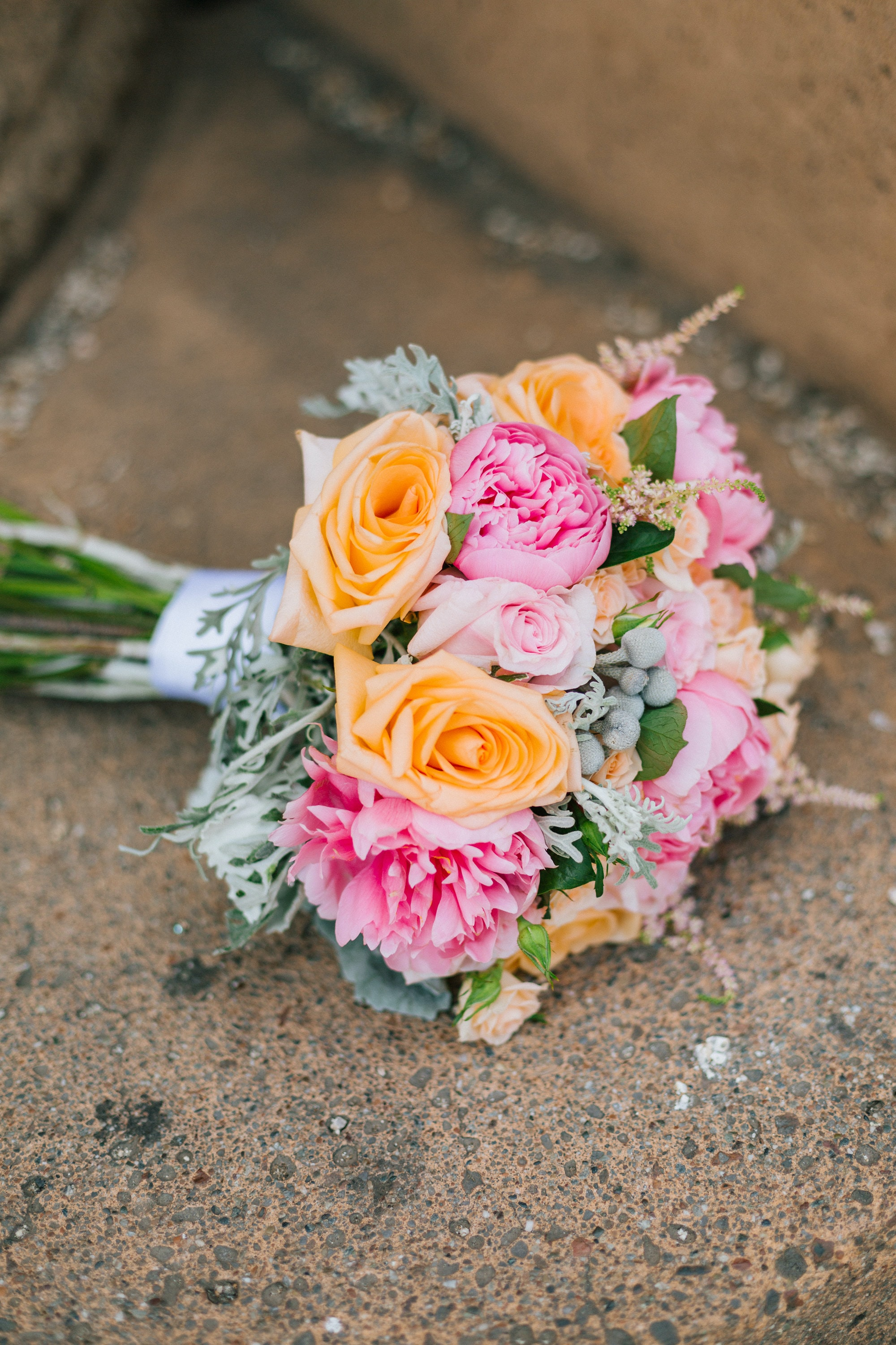 selective focus photography of pink and orange bouquet
