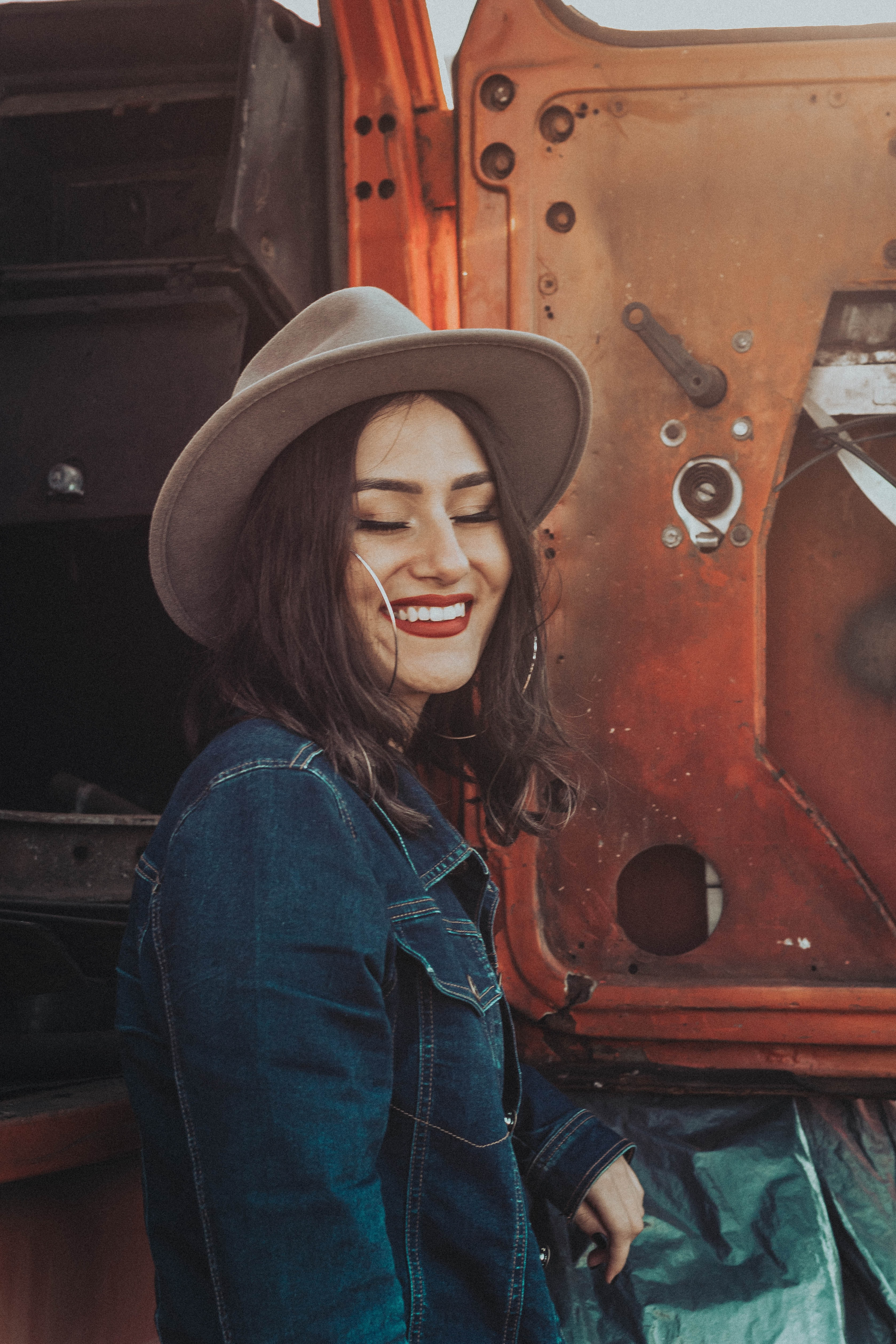 woman smiling beside tractor