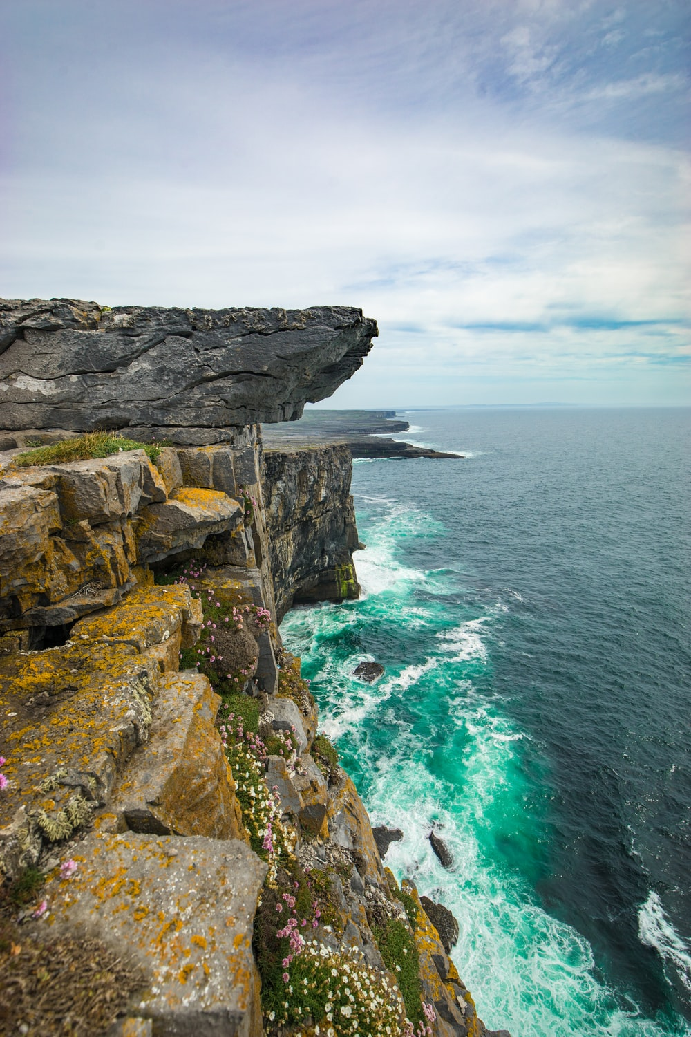 rock cliff with cloudy sky
