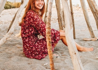 woman sitting on sand smiling