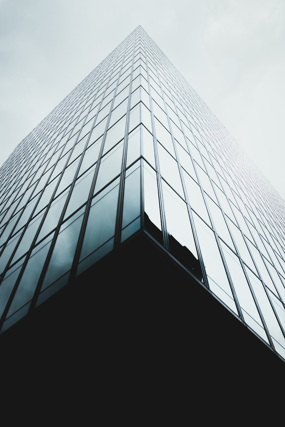 low angle photo of glass architecture wallpaper