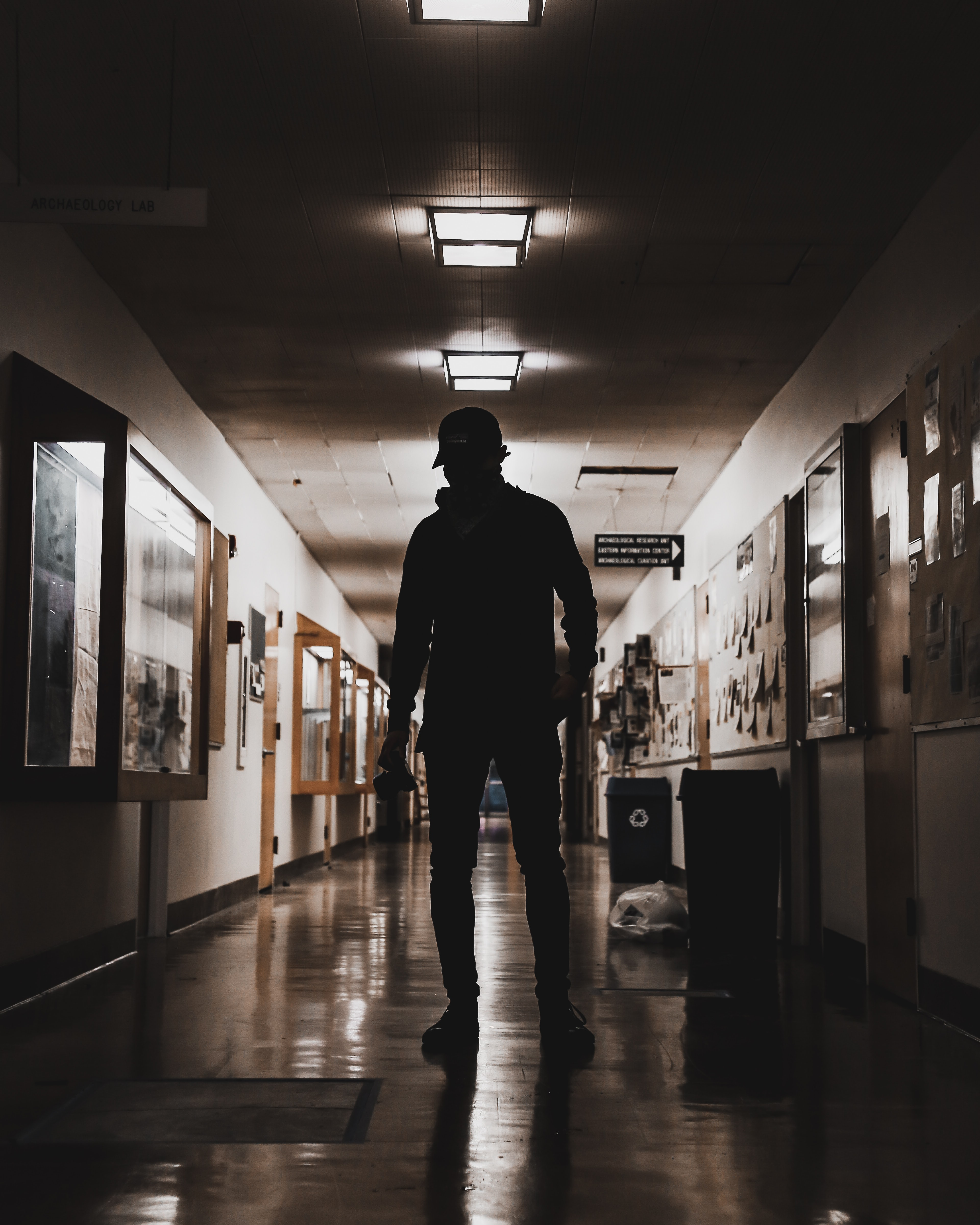 man standing on rooms pathway