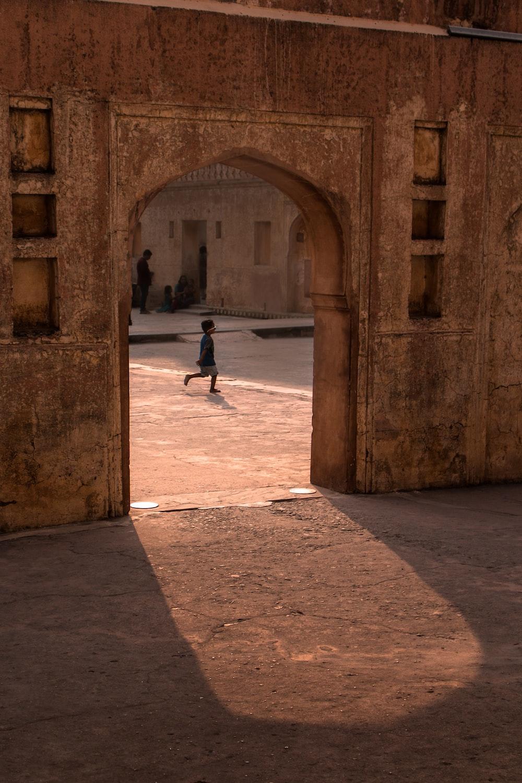 person walking on sidewalk during daytime